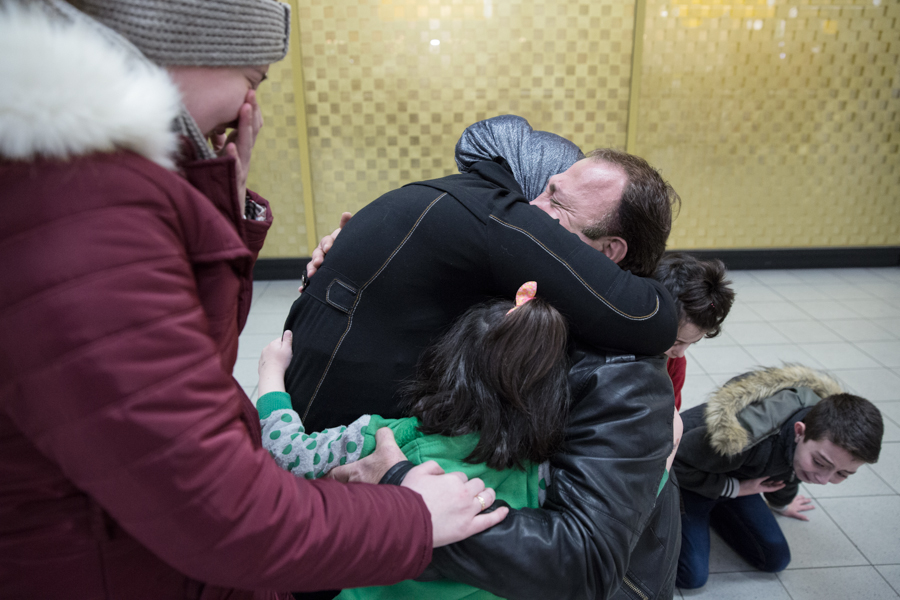 Mouataz Nasri (49) hugs his wife and children after they arrived from Syria, Monday November 27, 2017, at Amsterdam Airport Schiphol. Mouataz fled war-torn Syria in 2014 and was reunited after 3 years with his wife Amani, daugthers Maya (14), Marah (5), Farah (3) and their son Murad (10).