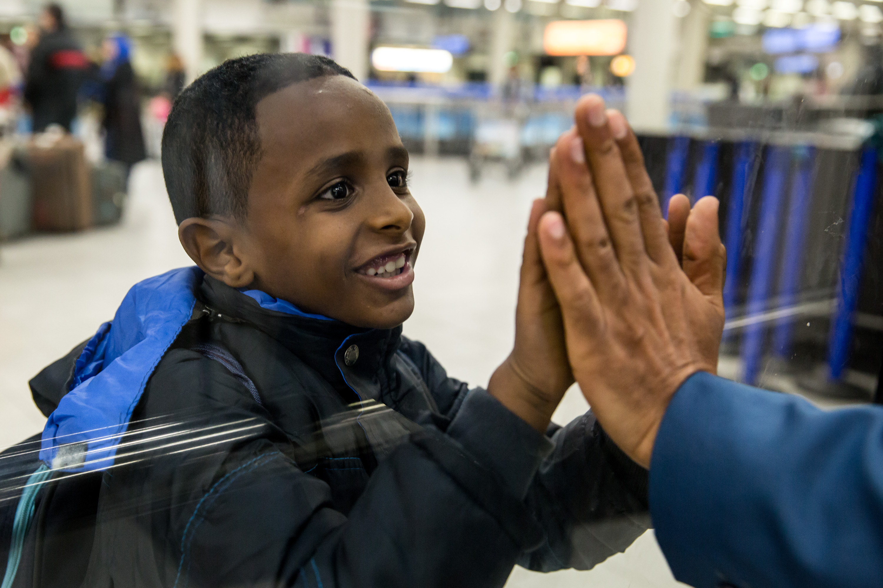 Mebrahtom (34) from Eritrea is reunited with his wife Ezwti (27), their son Israel (7) and daughter Betlehem (4) after more than two and a half years apart.